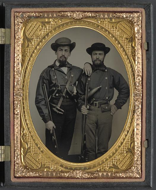 [Two unidentified soldiers in Mississippi battle shirts with double barrel shotguns, knives, and powder horns]