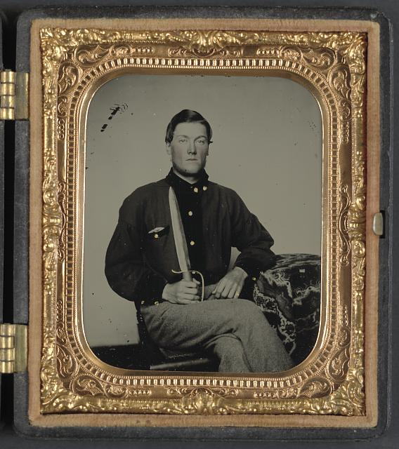 [Private David Bowman of Company H, 12th Virginia Cavalry Regiment, in uniform with knife]