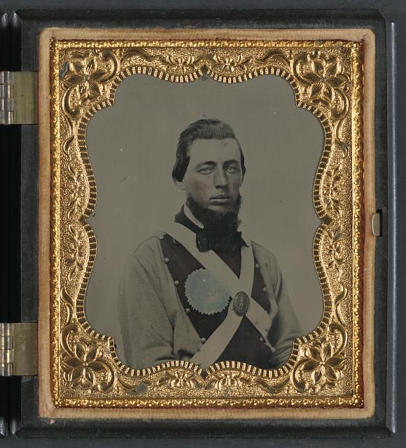 [Private Peter S. Arthur of Company B, 11th Virginia Infantry Regiment, in uniform with secession badge and Virginia state seal breastplate]