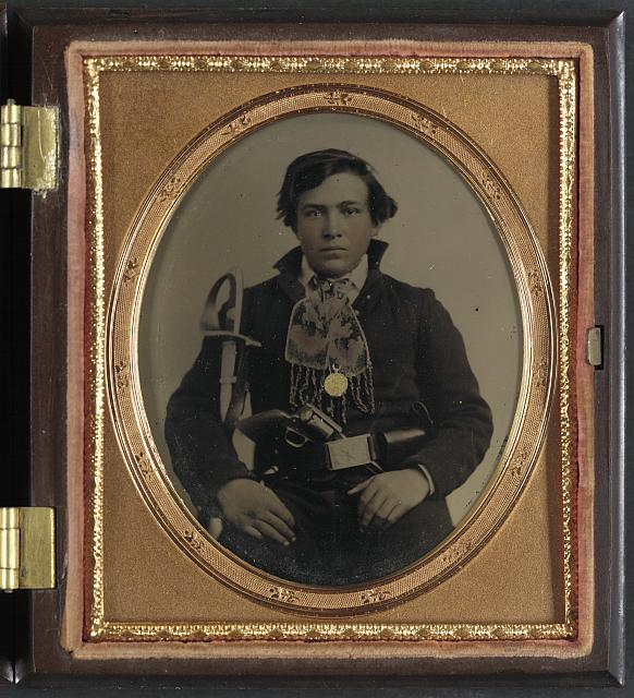 [Unidentified soldier in Confederate uniform with cavalry sword and revolver]