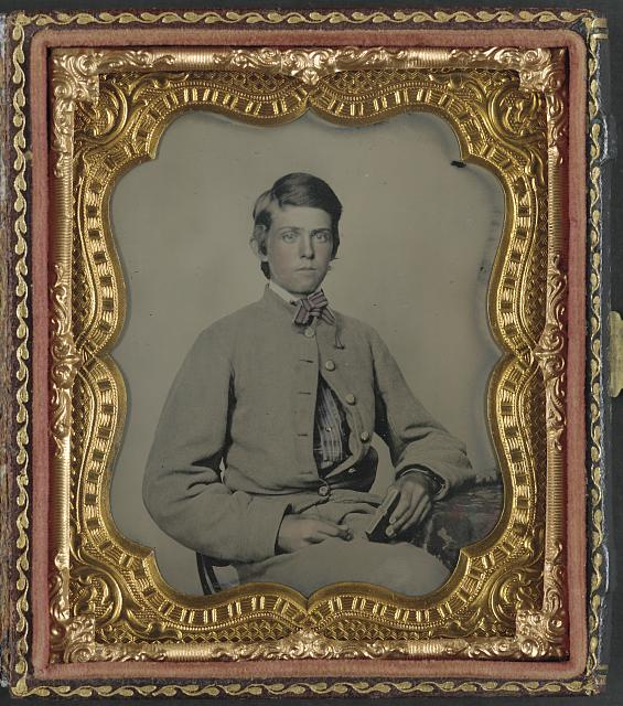 [Unidentified young soldier in Confederate private's uniform with cased photograph]