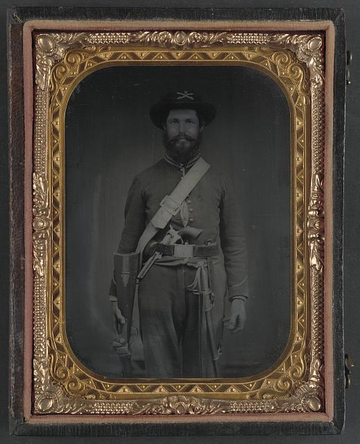 [Unidentified cavalry soldier in Union uniform with Sharps carbine rifle, Colt revolver, and cavalry saber]