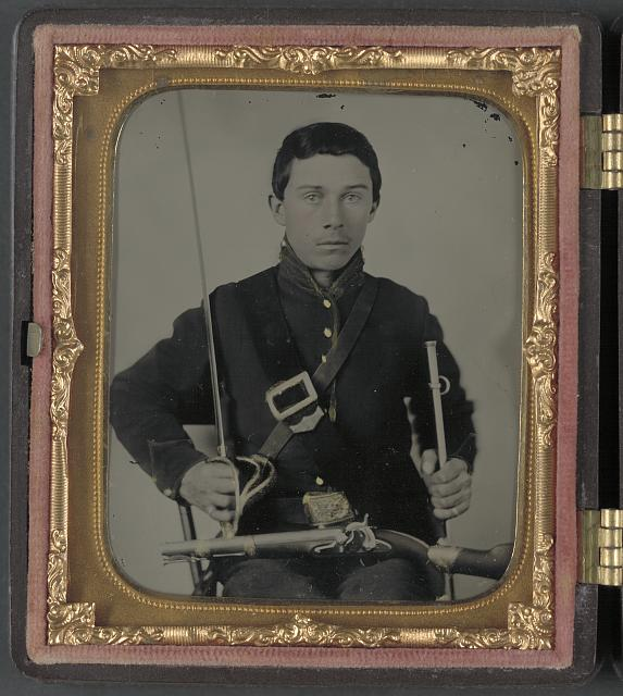 [Unidentified soldier in Union uniform with cavalry sword and U.S. Model 1855 pistol-carbine]
