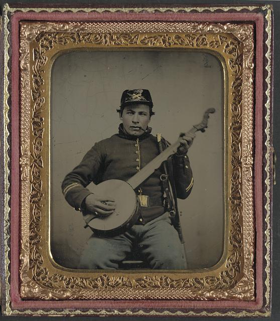 [Unidentified soldier in Union cavalry uniform with banjo, sword, and pipe]