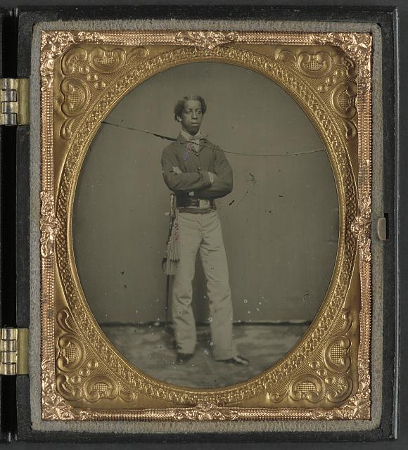 [Unidentified African American soldier in Union cavalry uniform with sword]