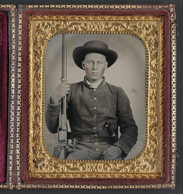 [Unidentified soldier in Confederate uniform with Colt Revolving rifle and D-Guard Bowie knife]