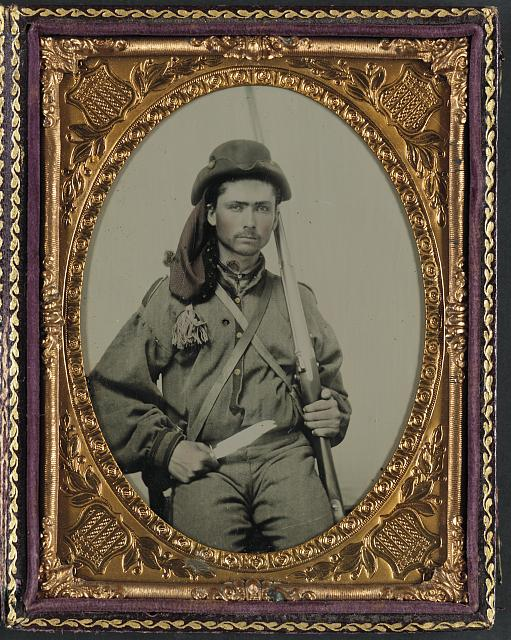 [Unidentified soldier in Confederate infantry uniform with musket and Bowie knife]