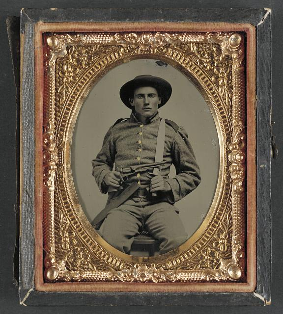 [Unidentified soldier in Confederate frock coat and slouch hat with Bowie knife and Colt Army Model 1860 revolver]