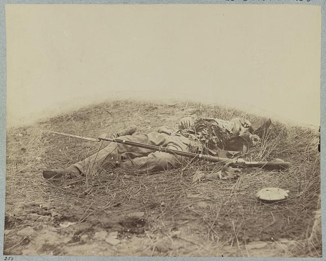 "Battlefield of Gettysburg.  Body of a soldier in ""the wheat field,"" evidently killed by the explosion of a shell"