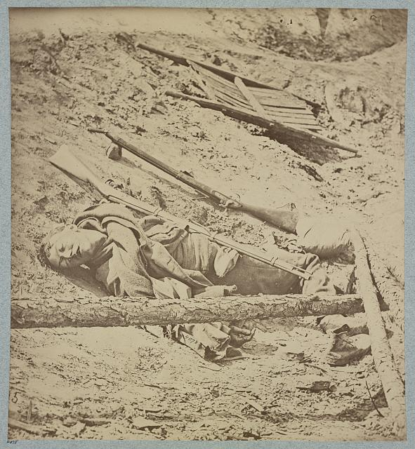 Dead Confederate soldier in trenches of Fort Mahone in front of Petersburg, Va., April 3, 1865