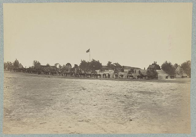 [Flag flying above an emcampment]