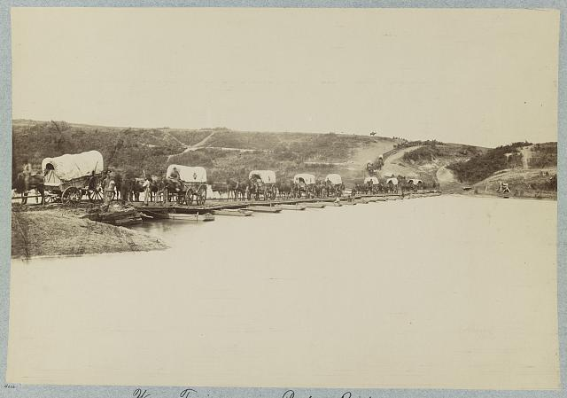 Wagon train crossing pontoon bridge, Rappahannock River, below Fredericksburg, Va.