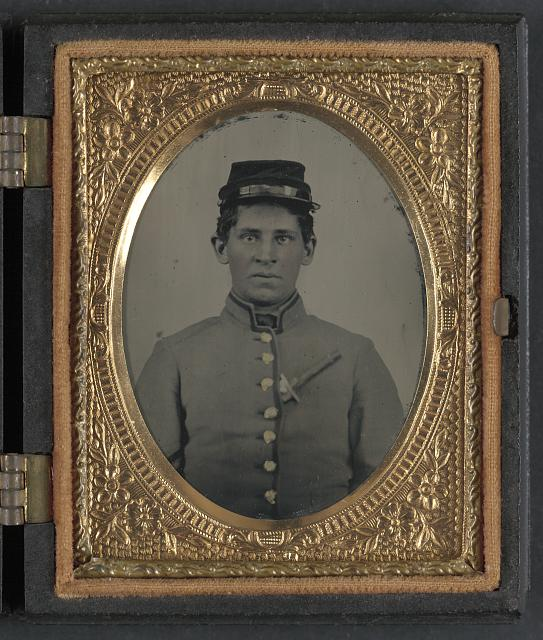 [Unidentified soldier in Confederate uniform with side knife in blouse]
