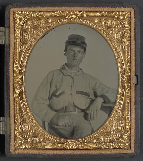 [Unidentified soldier in Confederate battleshirt, kepi, and wishbone belt buckle]