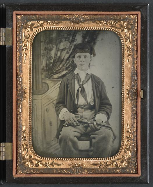 [Unidentified soldier in Confederate uniform with single shot percussion pistol]