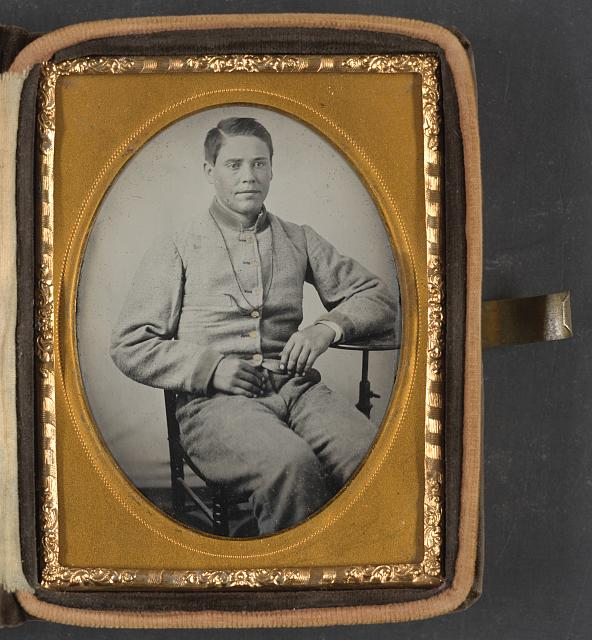 [Unidentified soldier in Confederate uniform with lanyard around his neck]