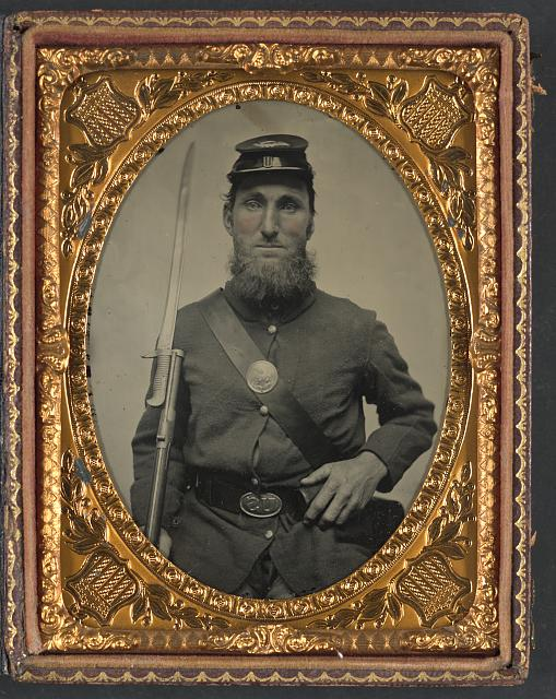 [Unidentified soldier in Union uniform with musket and saber bayonet]