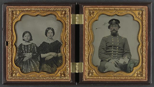 [Mollie Knopp Zigler, left, and Betty Hoover, right ; unidentified midshipman in Confederate uniform with book]