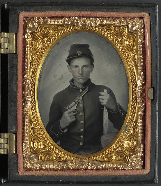 [Unidentified soldier in Union uniform with Colt revolver and Sheffield side knife]