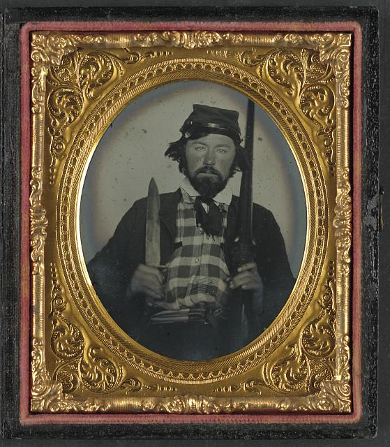 [Lieutenant Hiram L. Hendley of Co. A, 9th Tennessee Cavalry Battalion with double barrel shotgun and Bowie knife]