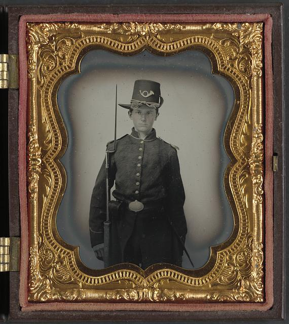[Unidentified young soldier in Union infantry uniform with Hardee hat and musket]