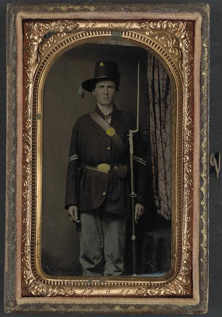 [Unidentified soldier in Union infantry uniform and Hardee hat, with bayoneted musket]