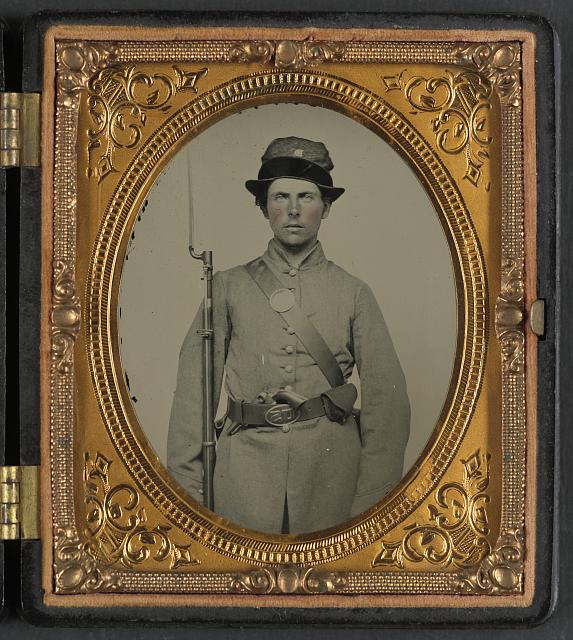 [Unidentified soldier in New Hampshire uniform and Co. D Whipple hat with bayoneted musket and revolver]