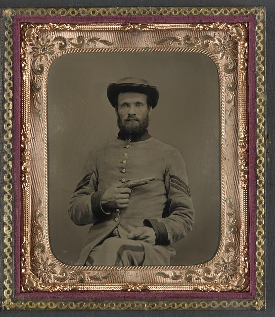 "[Unidentified soldier in Confederate uniform with 11"" Derringer single shot pistol]"