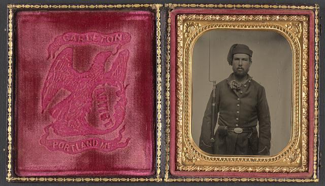 [Unidentified soldier in Union infantry uniform and Volunteer Maine Militia belt buckle with bayoneted musket]