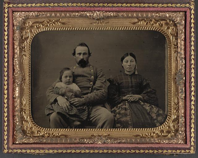 [Unidentified soldier in Confederate 1st lieutenant's uniform with wife and baby]