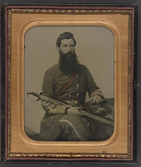 [Captain George W. Hackworth of Co. F, 1st Virginia Cavalry Regiment, in uniform with sword]