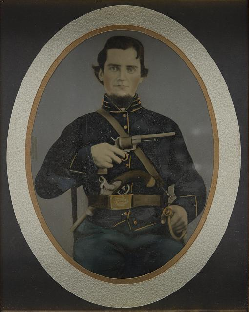 [Private Silas York of Co. F, 5th Illinois Cavalry Regiment, with single shot percussion pistol, Lefaucheux revolver, and sword]