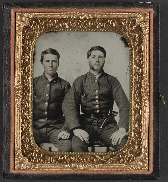[Brothers Private Stephen D. and Private Moses M. Boynton of Co. C, Beaufort District Troop, Hampton Legion South Carolina Cavalry Battalion, with pistol]