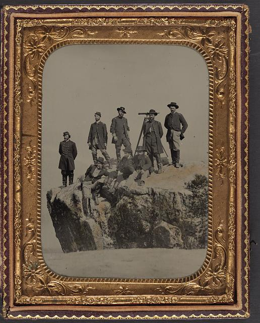 [Seven unidentified officers and soldiers in Union uniforms and one officer identified as Major Charles S. Cotter of 1st Ohio Light Artillery Regiment, with telescope, at Point Lookout, Tennessee]