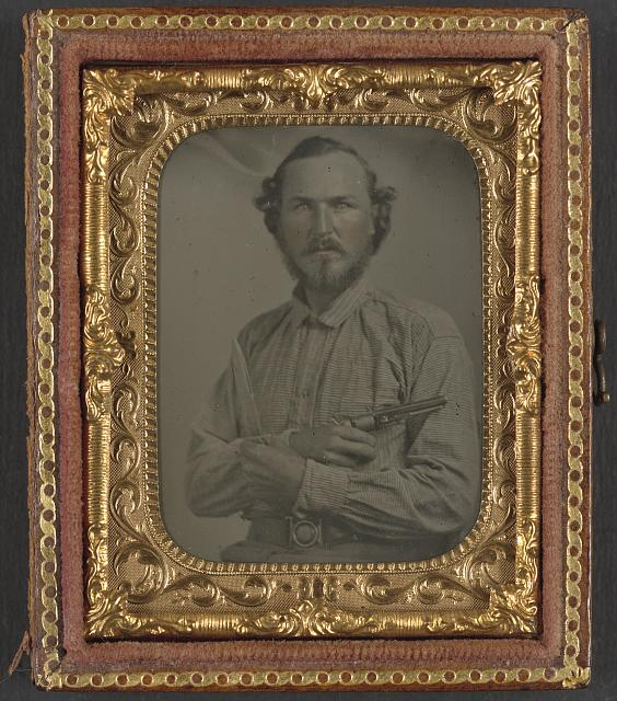 [Unidentified soldier in Confederate uniform with Bowie knife and revolver]