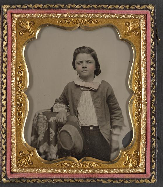 [Unidentified young boy with Confederate kepi]