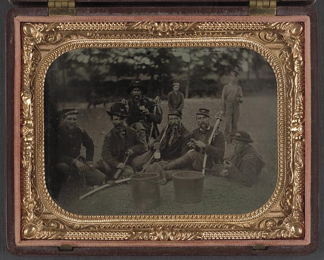 [Six unidentified soldiers in 45th Ohio Infantry Regiment officers' uniforms with sabers]