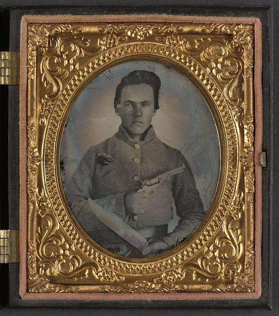 [Soldier named E.F. Powell in Confederate uniform with Bowie knife and revolver]