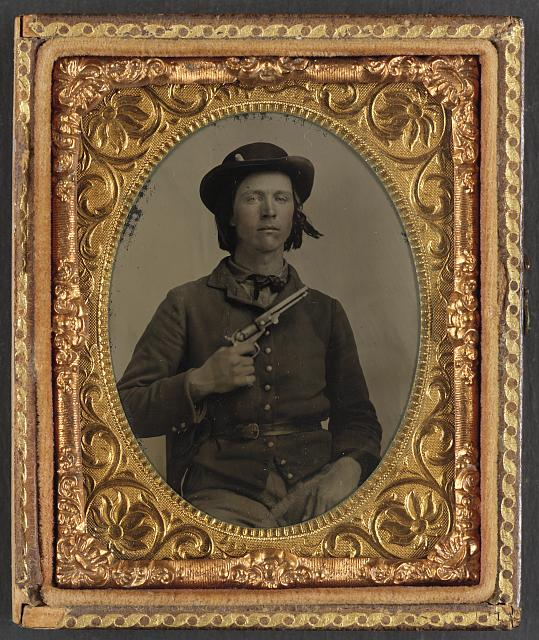 [Unidentified soldier in Confederate uniform with revolver]
