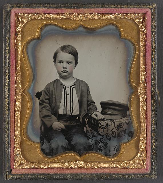 [Unidentified boy in zouave-style shirt with engineer&#39;s cap]