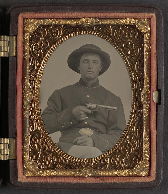 [Unidentified soldier in Union enlistedman's uniform and U.S. beltplate with Marston revolver]