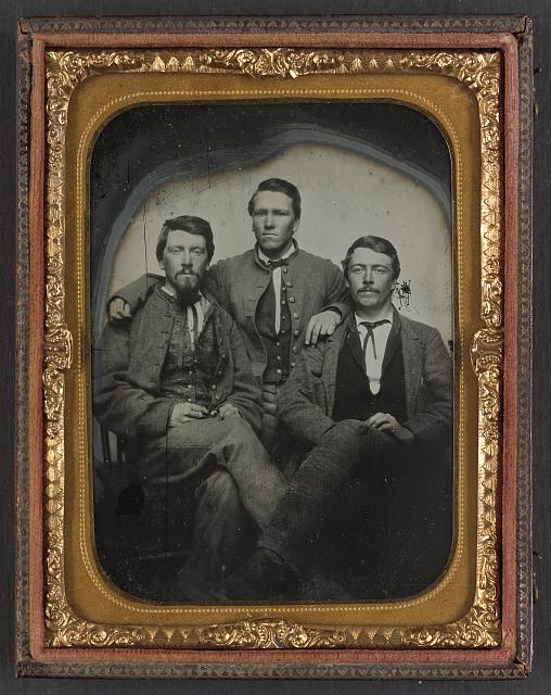 [Three unidentified soldiers in Confederate uniforms]