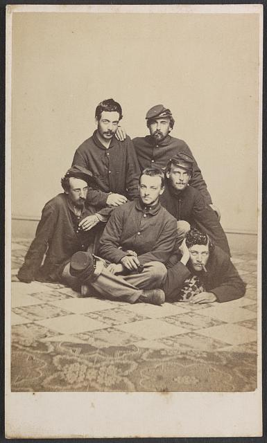 [Six unidentified soldiers in Union uniforms with cigars and pipe]