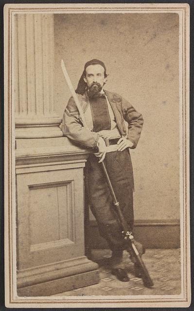 [Sergeant Henry G. Lillibridge of Co. H, 10th Rhode Island Infantry Regiment, in zouave uniform with saber bayoneted rifle]