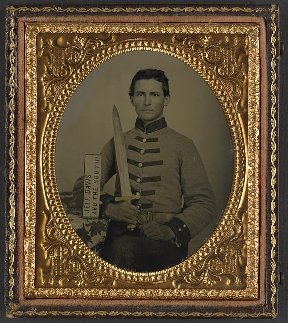 [Private Henry Augustus Moore of Co. F, 15th Mississippi Infantry Regiment, with artillery short sword and sign reading Jeff Davis and the South!]