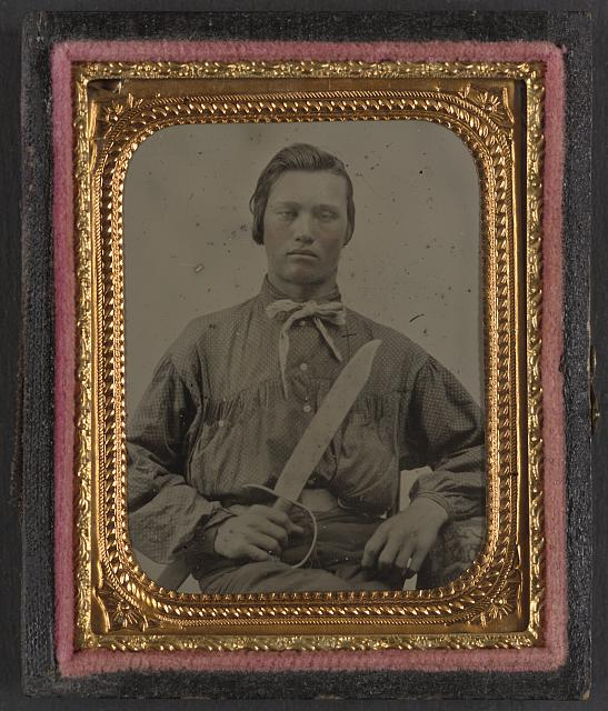 [Unidentified soldier in Confederate uniform with D guard Bowie knife]