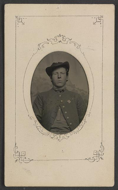 [Unidentified soldier in Union uniform with 6th Corps badge with cross shape]