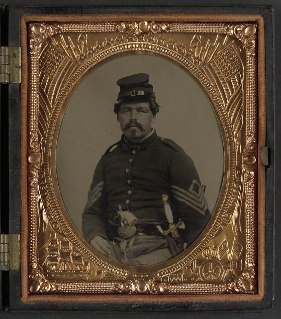 [Unidentified soldier in Union first sergeant's uniform with militia sword and revolver]