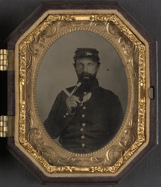[Unidentified soldier in Union uniform with combination fork-knife-spoon eating utensil]