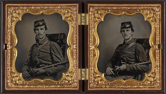 [Two unidentified soldiers, probably brothers, in Union corporal's and private's uniforms with rifle muskets and revolvers]